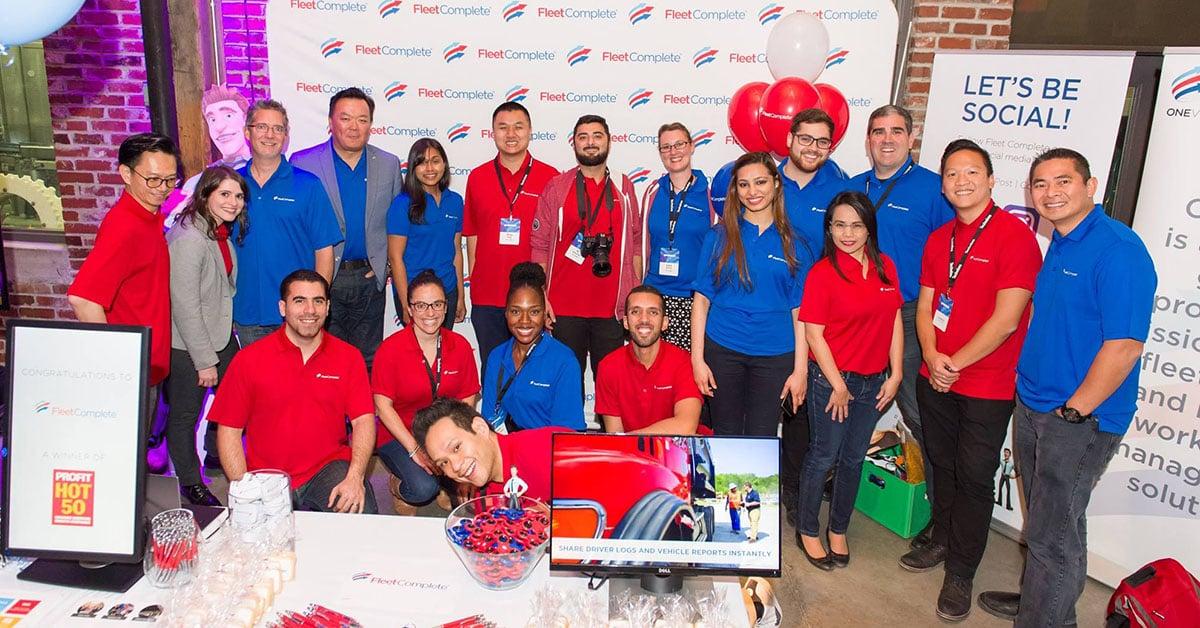 Sai and fellow devs at a tech job-fair event