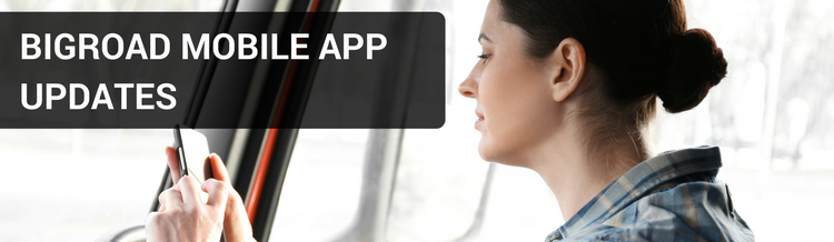 Female truck driver using the BigRoad Mobile App on phone
