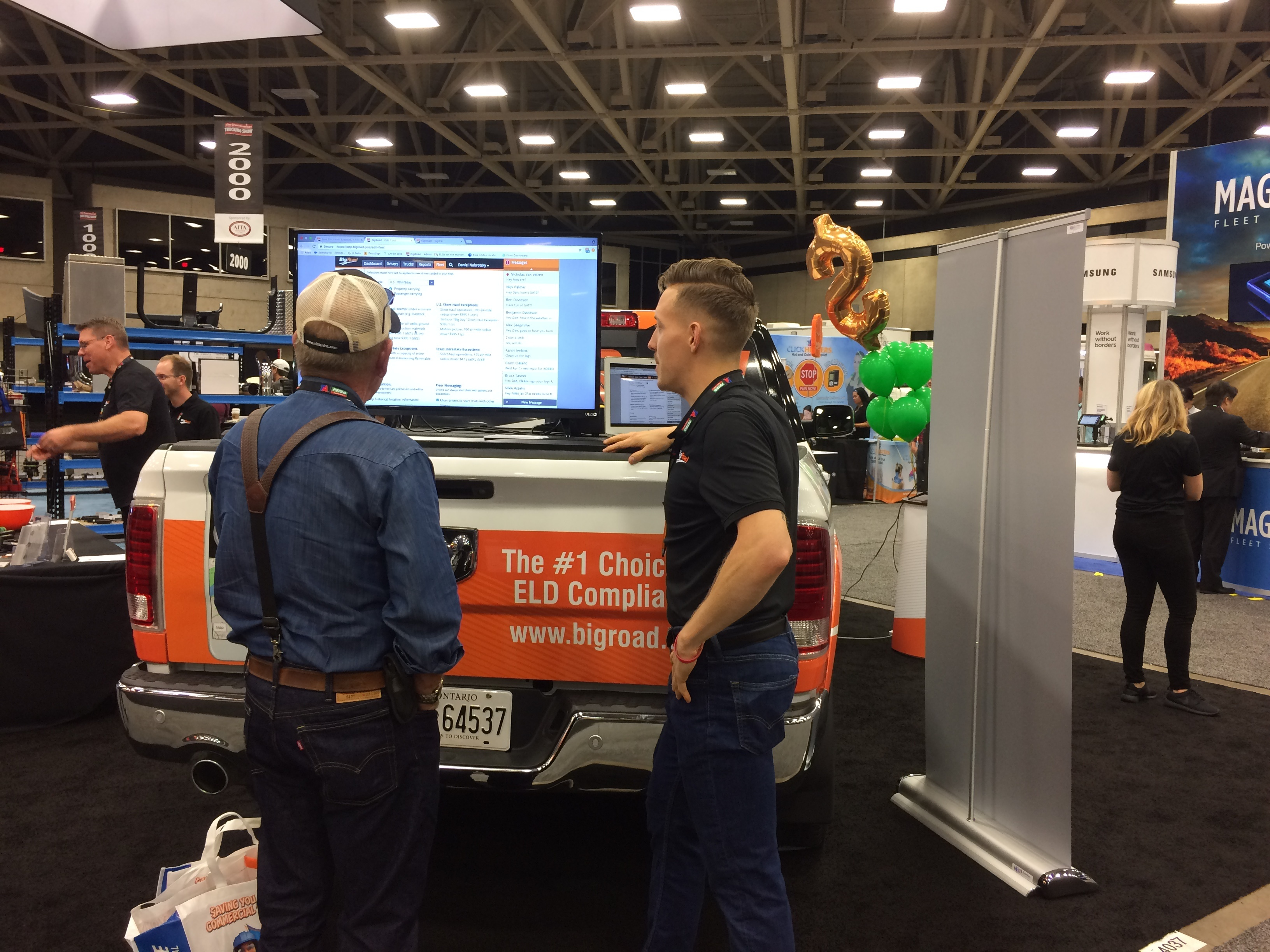 BigRoad Booth with Ben talking to a Customer