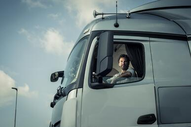 truck driver in cab of truck
