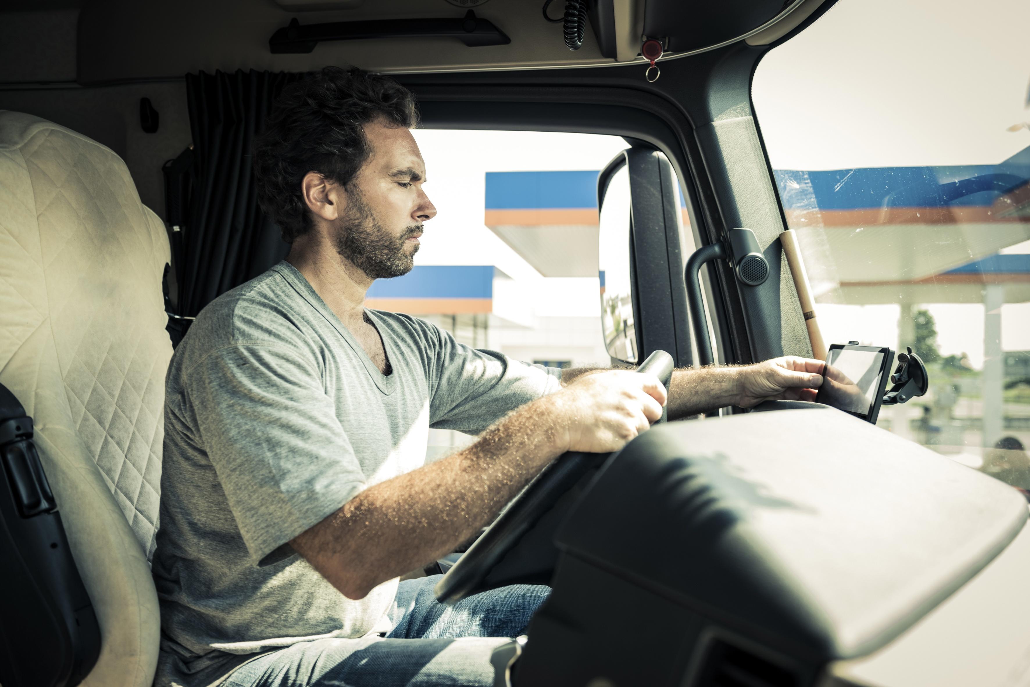 Trucker using E-Log on tablet