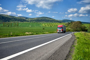 Truck hauling goods through countryside