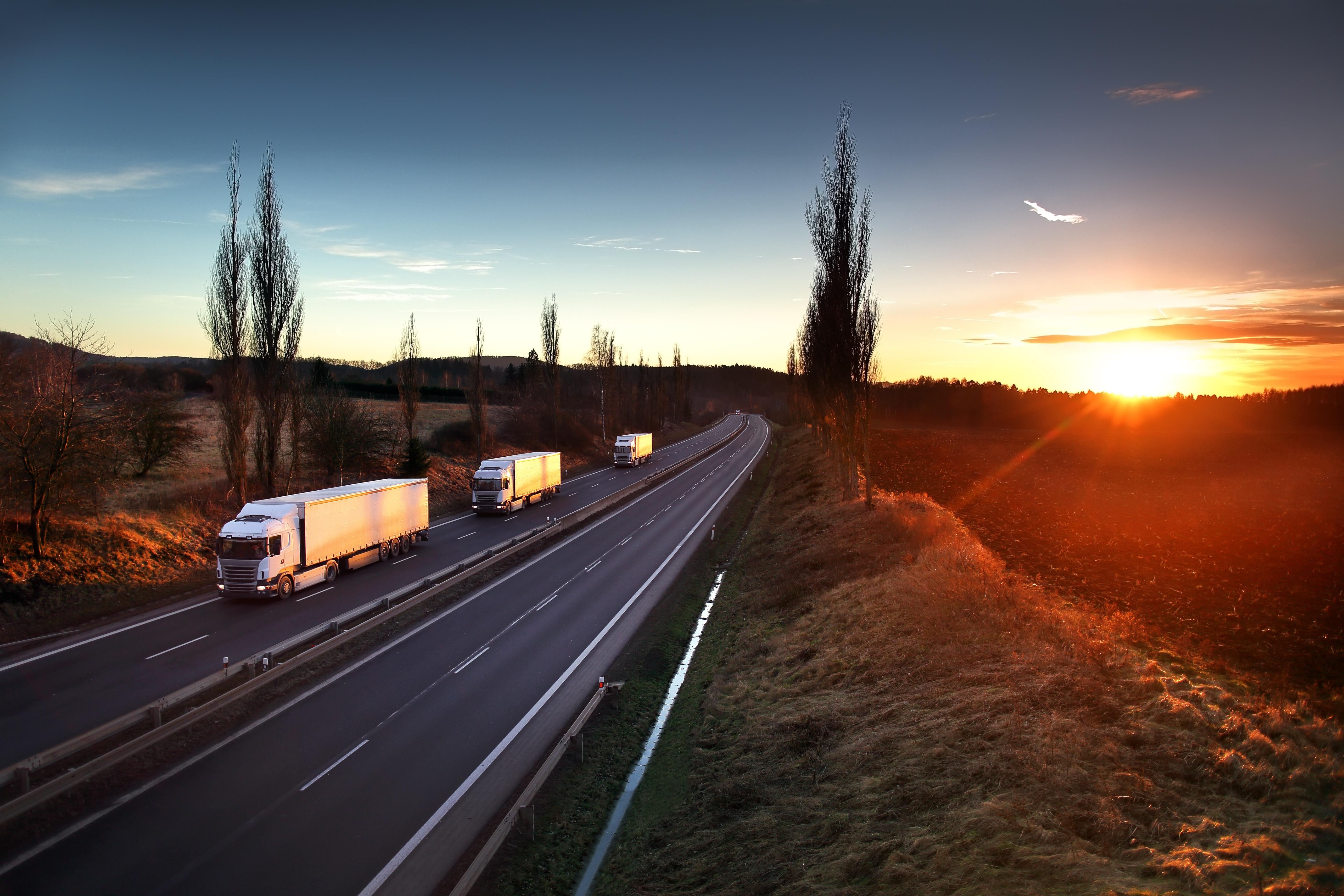 trucks driving on highway