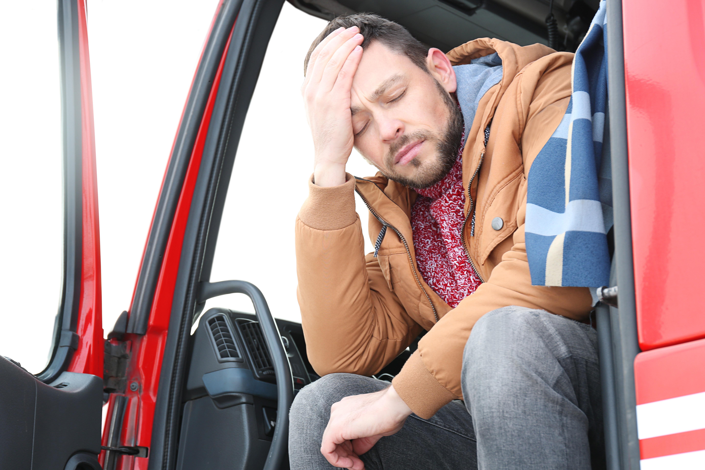 Sleepy Trucker Sitting in Cab