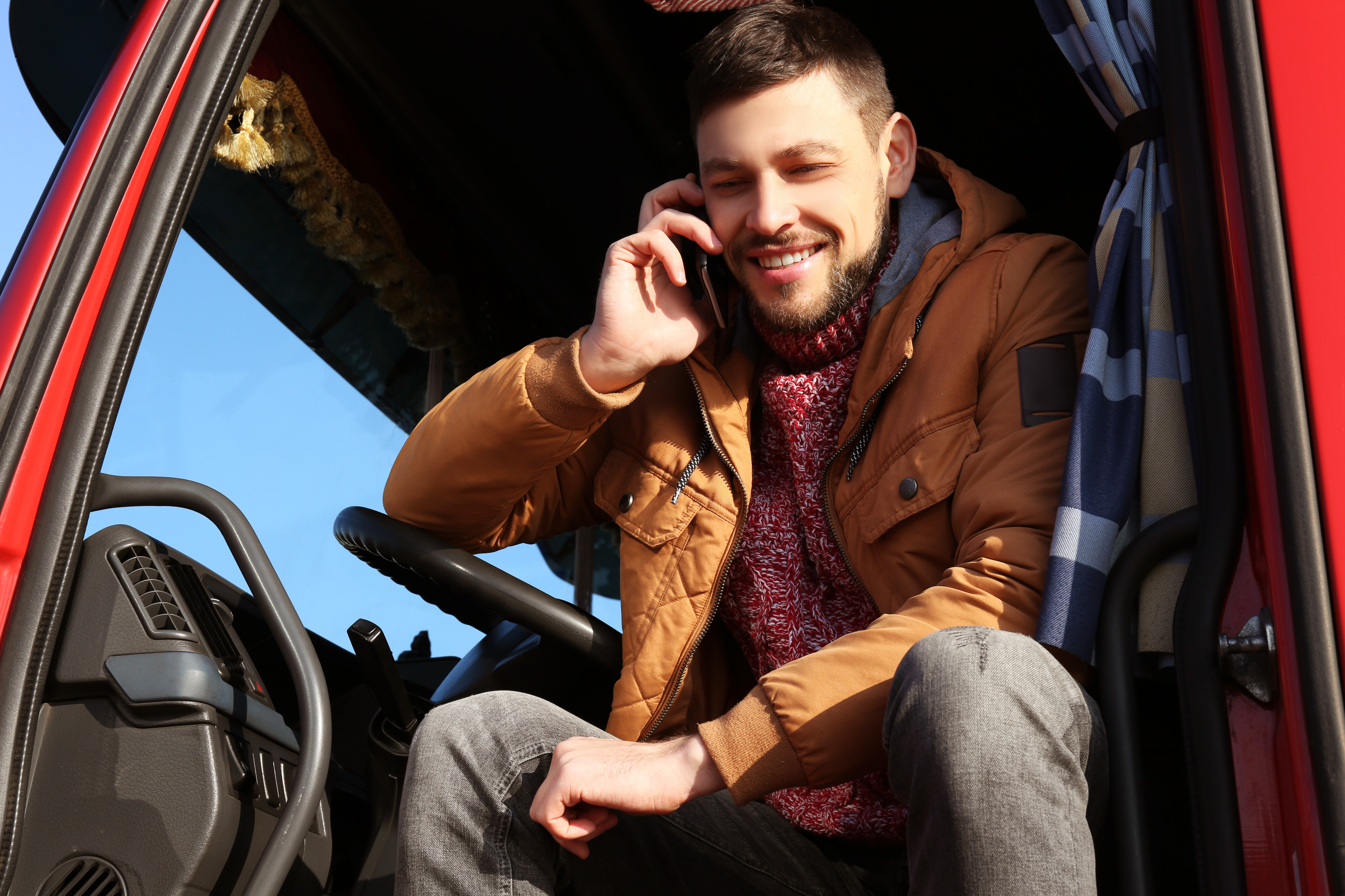 Young Truck Driver on the Phone with a Friend