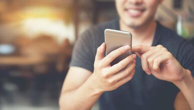 man updating is mobile app