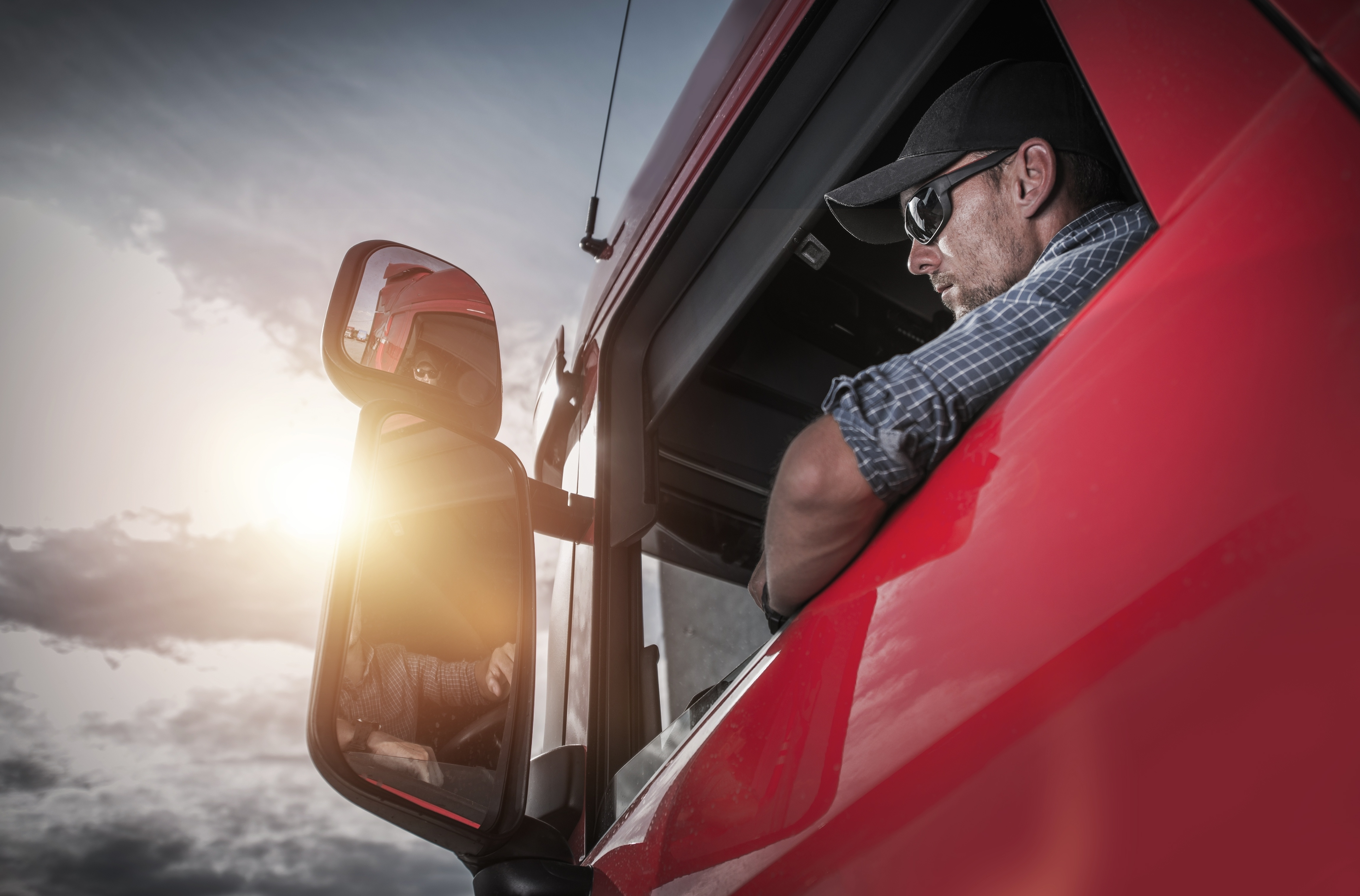 truck driver looking out the window of his truck