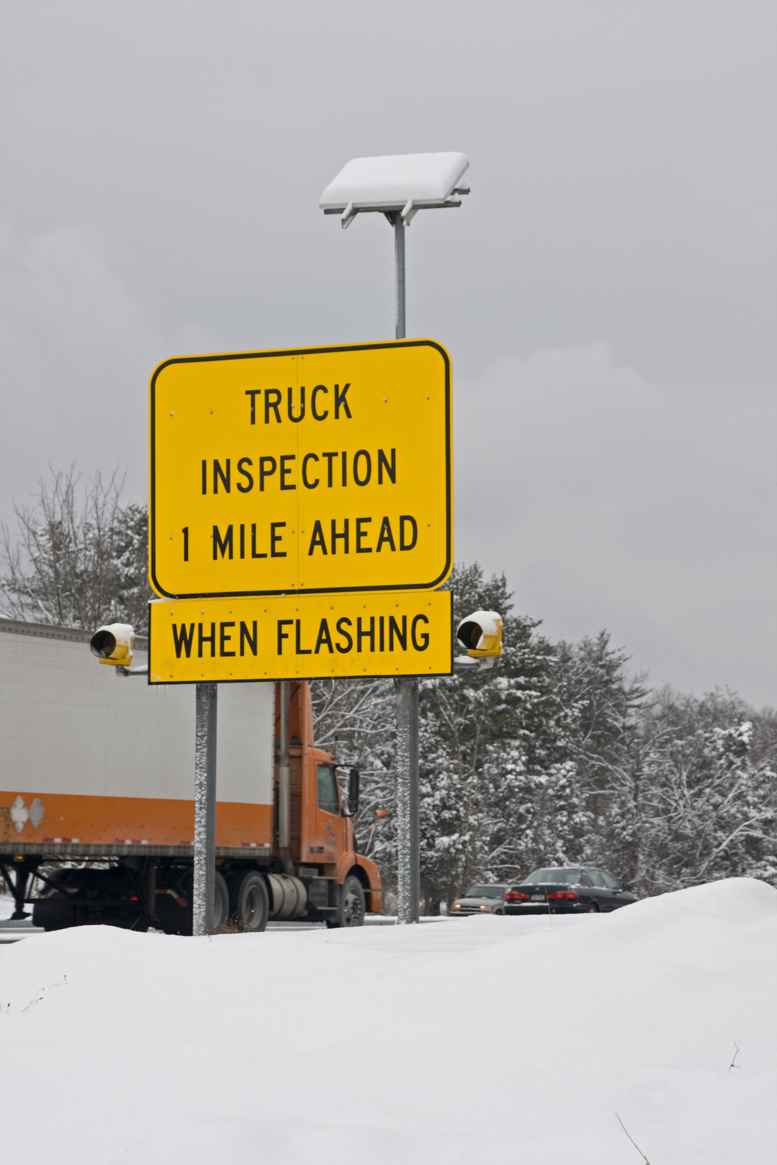 truck inspection 1 mile ahead sign